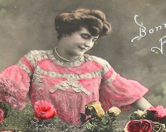 1900s French postcard, Lady in pink with roses, RPPC real photo postcard, paper ephemera.