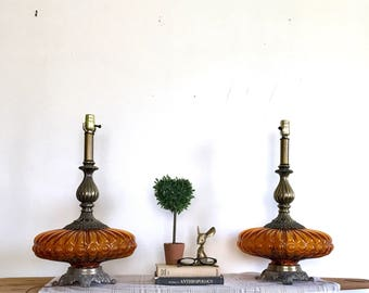 Pair of Vintage Hollywood Regency Style Amber Glass and Brass Table Lamps