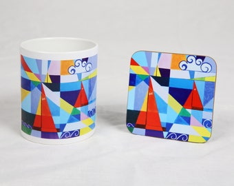Mug and coaster set showing artwork of sailing boats, Cornwall