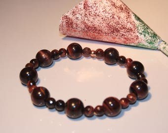 Red tigers eye with a rose gold plated 925 sterling silver spacer, adjustable bracelet