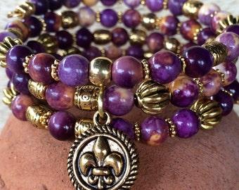 Handmade purple and yellow ocean white jade 3-wrap memory wire bracelet with fleur de lis charm.