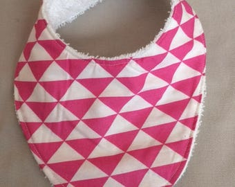 bandana bib in triangle fuschia lined with a white Terry cloth fabric