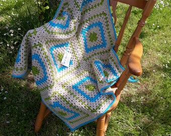 crocheted granny square baby blanket