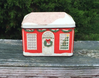 Tin Christmas Time Tin Made in England Exclusively For Avon New England Cottage Red Winter Scene