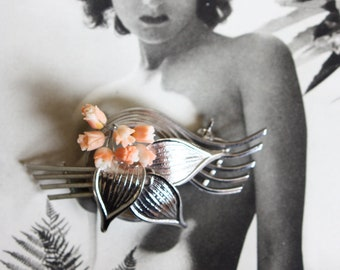 A fabulous 1950s chrome plated brooch, with peach lucite flowers.