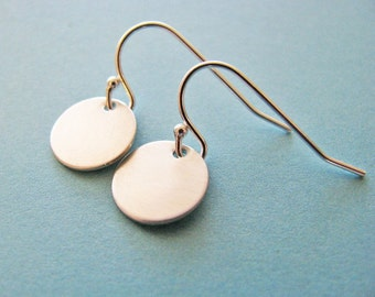 round silver dangle earrings