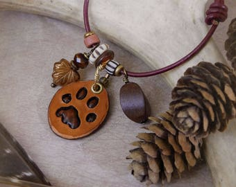 Bobcat - woodland charm bracelet with leather, wood, brass