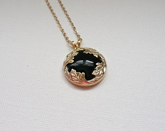 nnm-Black and Gold Pendant on a Gold Plated Chain