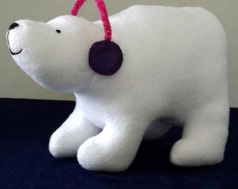Stuffed polar bear in white fleece with removable earmuffs
