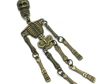 1 skeleton bronze tone articulated charm,97mm  # CH 109
