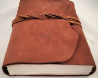 Leather journal with handmade paper.