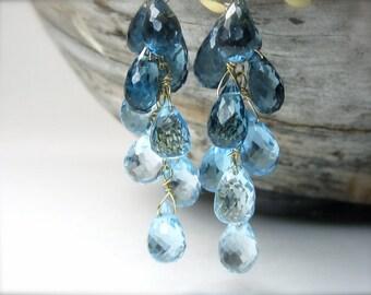 Blue topaz earrings in 18K gold. Swiss London blue topaz dangle earrings.  Blue gemstone cascade briolette earrings. November birthstone.