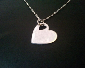 sterling silver love heart in a heart pendant