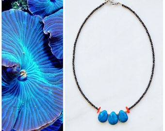 CSC013 - Minimal statement necklace with bright blue howlite stones, peach corals, white pearls and charcoal grey crystals.