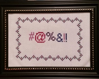 Finished cross stitch. #@%&!!