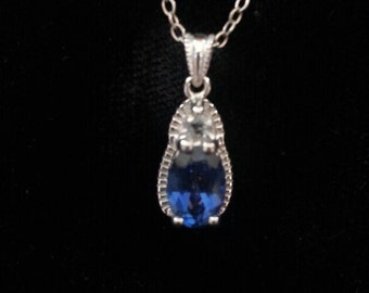Sterling silver necklace with a Sapphire colored stone and rhinestone