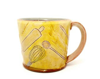 Puffy baking themed Earthenware mug. Wheel thrown, food safe mug made by Kaitlyn Brennan. This is a big handmade mug perfect for coffee