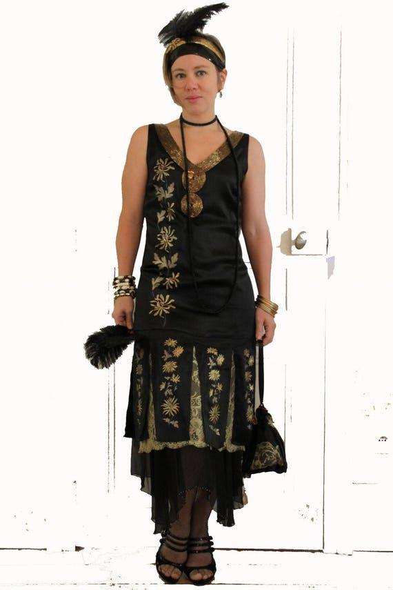 robe ann es folles noire et or robe ann es 20 en soie noire. Black Bedroom Furniture Sets. Home Design Ideas