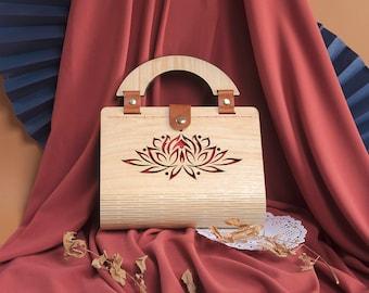 Wooden evening bag with flower cut design
