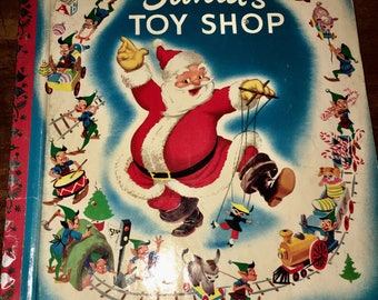 Vintage Santas toy shop book  1950