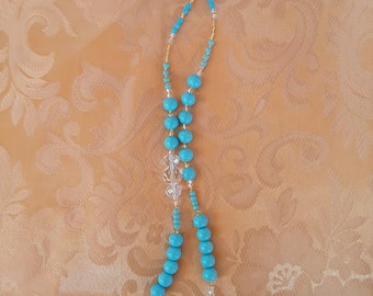 Charming baby blue necklace.