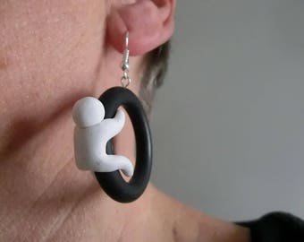 Rubber ring with eyelet and earhook/ 23 mm. black ring with small white polymer puppet on it/ cut  fake gauge  ring  possible