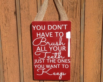 You don't have to brush all your teeth, just the ones you want to keep, sign, bathroom decor
