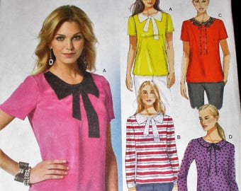 Butterick pattern, B5817, misses fitted pullover top, applique front, back neck slit, long and short sleeve tops, sz: 6, 8, 10, 12, 14