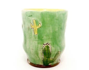 Puffy Cactus themed Earthenware Tumbler. Wheel thrown and altered, food safe cup, made by Kaitlyn Brennan/ Brennan pottery