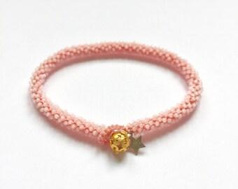 Beaded crochet friendship bracelet with gold button bead