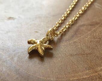 Tiny Starfish - cute necklace with a little starfish. goldtone, gold, cute, modern, hip, trendy, boho, bohemian, trend, fashion, beach, sea