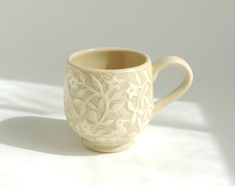 Yellow Cup Hand Carved in a Lacy Design with Flowers and Birds