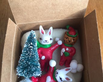 Snowball fight in a box. Miniature bunny and cat snowball fight set. Animal Diorama. Miniature cat and bunny scene