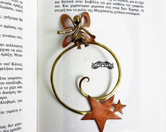 Metal bookmark with a fairy standing on a coil with stars. Book accessories. Gifts for her. Gift for book lovers.