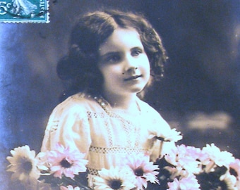 1910s French postcard, Girl with flowers, RPPC paper ephemera. Real photo.