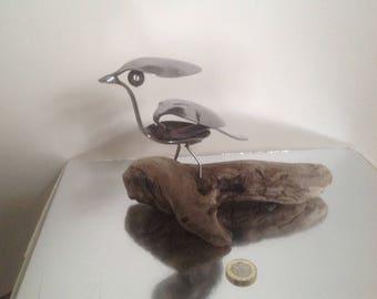 Bird sculpture on driftwood