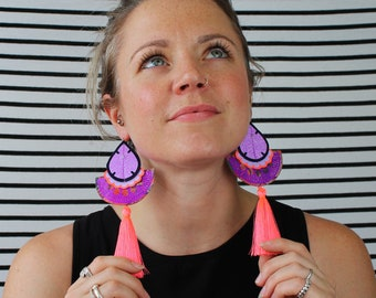 FLUORESCENT TASSEL EARRINGS in neon coral and purple glitter. U.V. Reactive, statement festival jewellery. Colourful earrings.