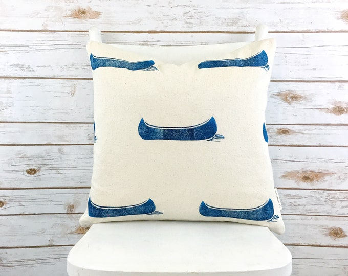 Organic accent pillow with navy canoes