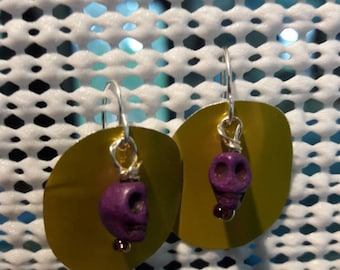Yellow and purple earrings with skulls