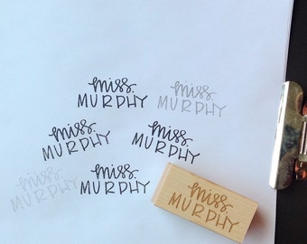 Custom hand lettered wooden rubber stamp