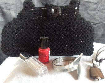 Midnight bag. A subtle but simple evening bag made with black lurex wool