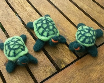 Handmade needle felted turtles.