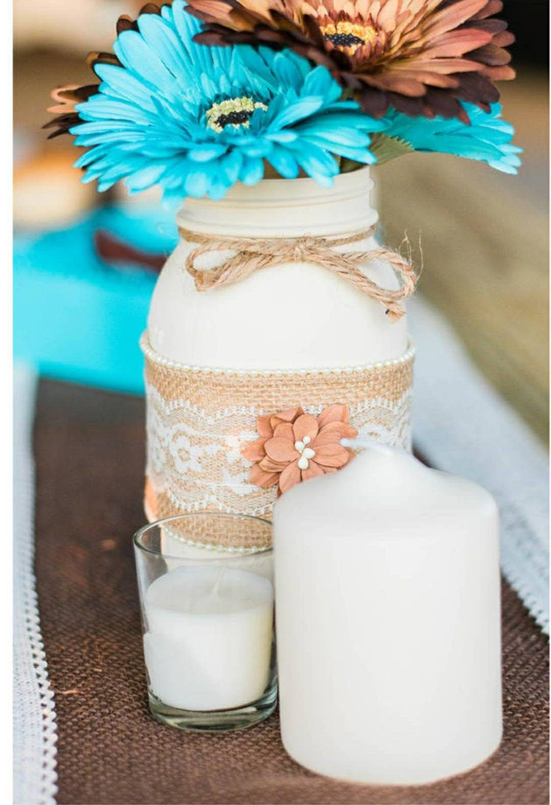 Rustic but elegant mason jar wedding centerpiece. Barn wedding