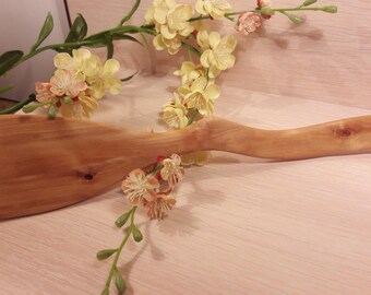 A Little Curved Handmade Spatula Made of Birch Tree