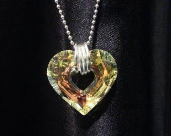 Swarovski open heart on long ball chain.