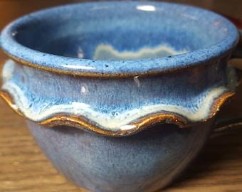 Blue handcrafted ceramic mug.