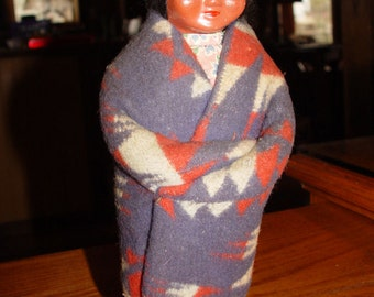 "Wonderful vintage old ""Skookum"" Native American Indian Doll with side-glancing eyes and blanket wrap"