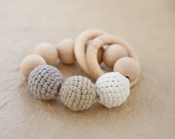 Teething toy with crochet wooden beads and 2 wooden rings. Light grey, beige, white wooden beads rattle.