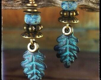 Artisan earrings #81...green patina metal leaves / mottled glass beads