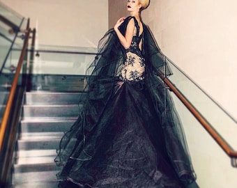Irina Shabayeva Couture  lace applique gown with layered tulle bottom abd tulle sleeve capes. Comes in white, black , nude , grey, and red.